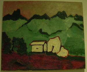 Häuser vor Gebirge